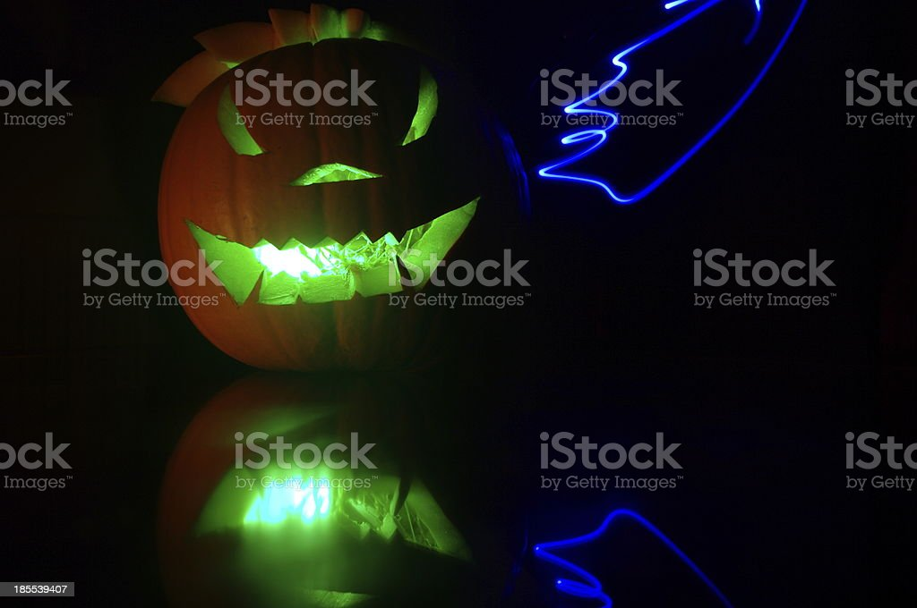 Green Illuminated pumpkin with light painting royalty-free stock photo