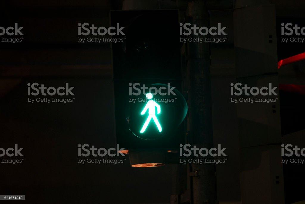 A green illuminated walk street pedestrian signal stock photo