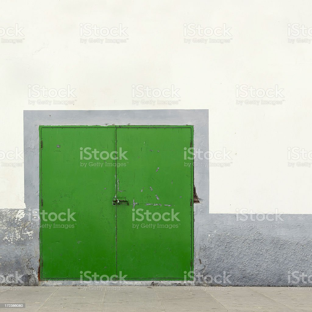 Green industrial door stock photo