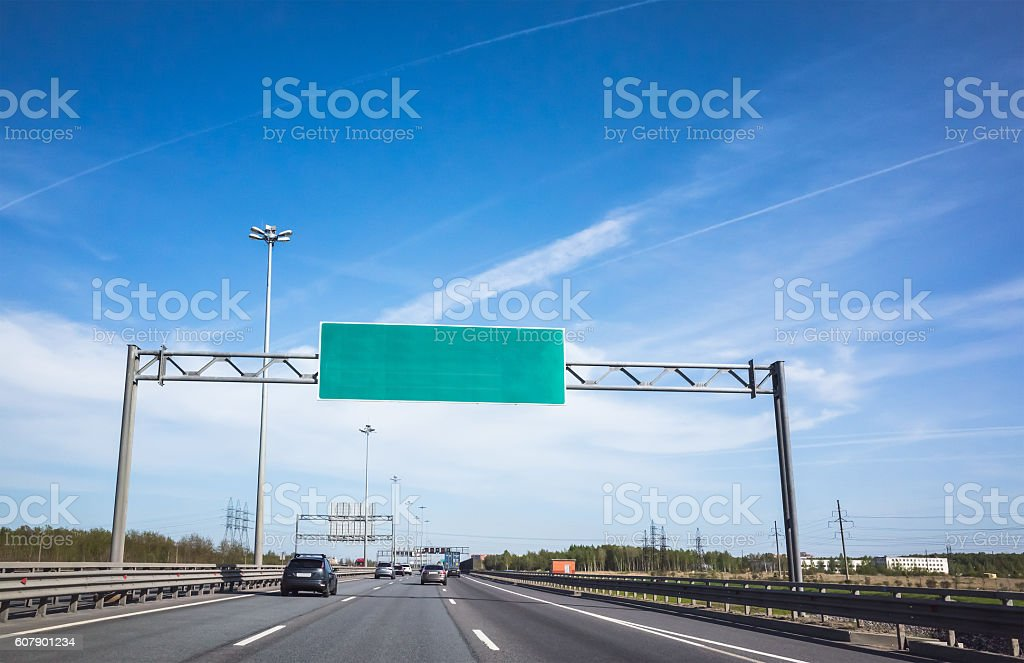 Green information banner over traffic lanes stock photo