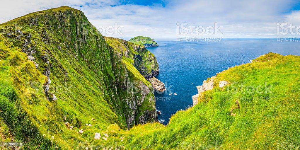 Green island cliffs blue ocean St Kilda Outer Hebrides Scotland stock photo