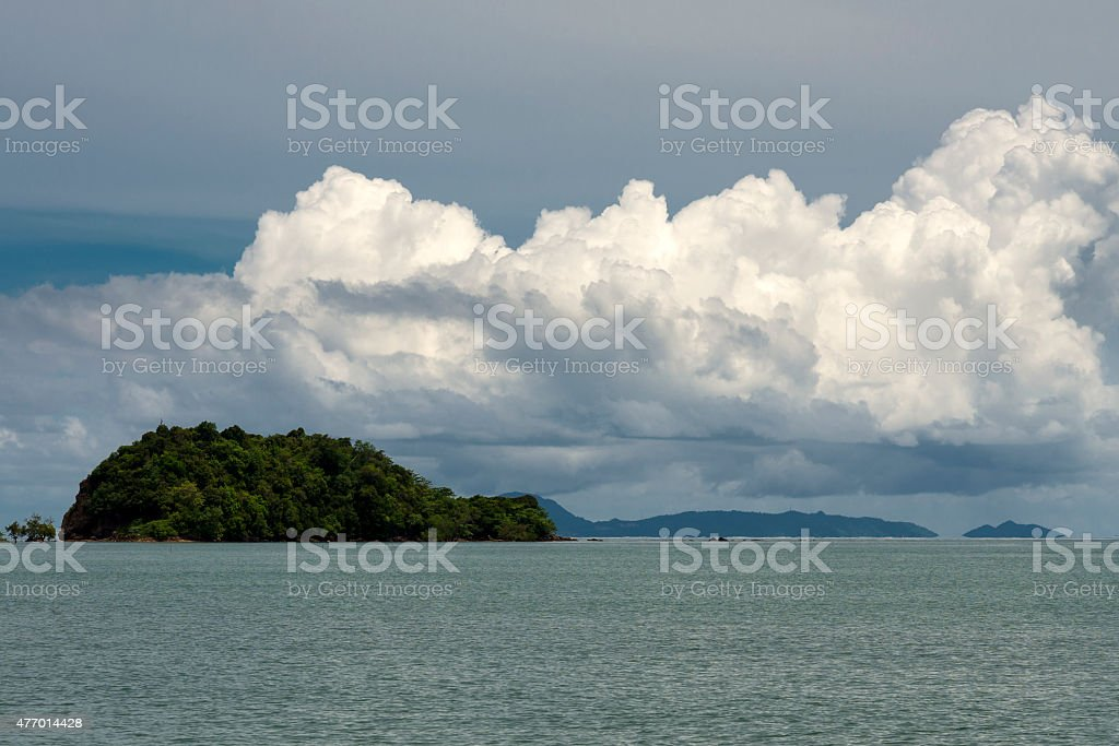 Green island in the ocean at Thailand stock photo