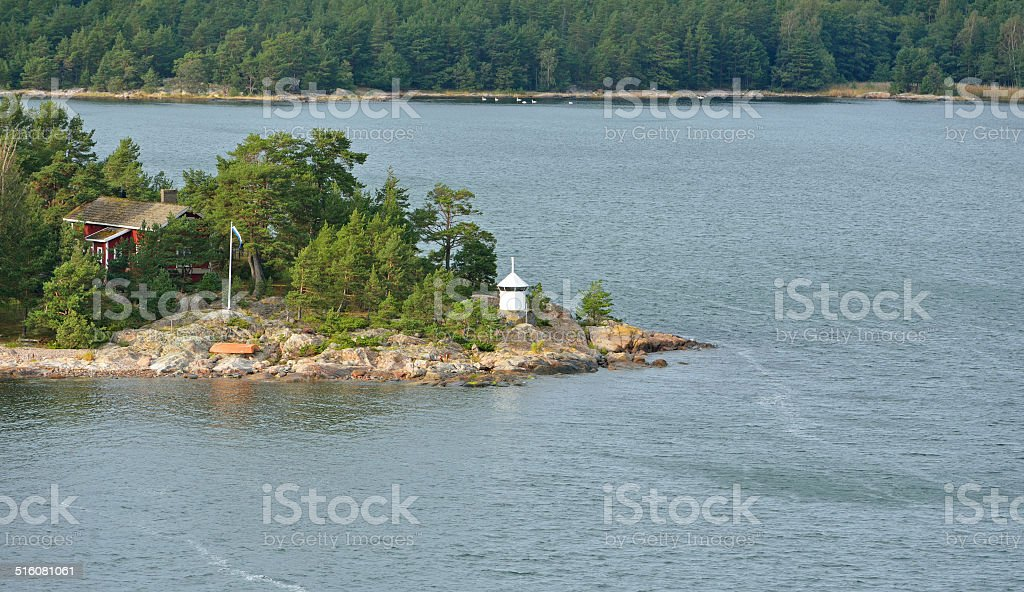 Green Island with red house and lighthouse stock photo