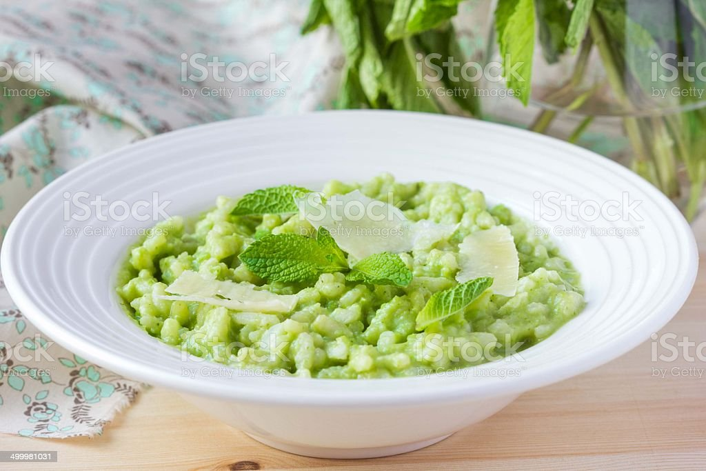 Green Italian risotto with peas, mint, crispy, tasty stock photo