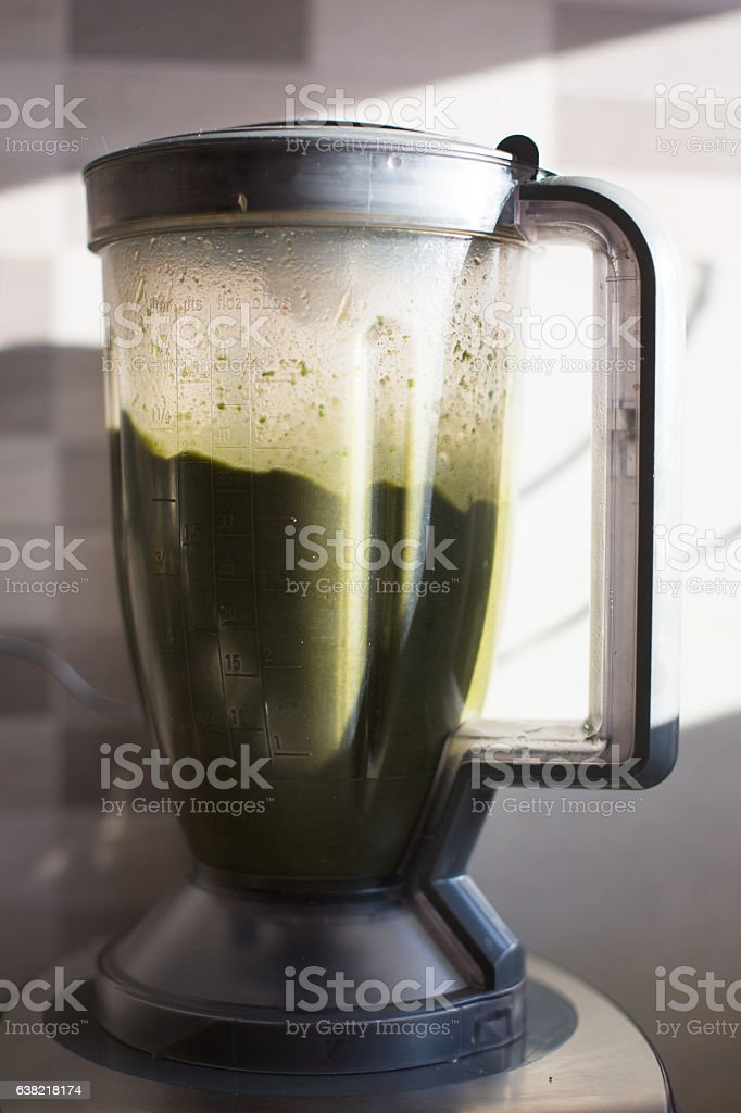 Green juice in blender stock photo