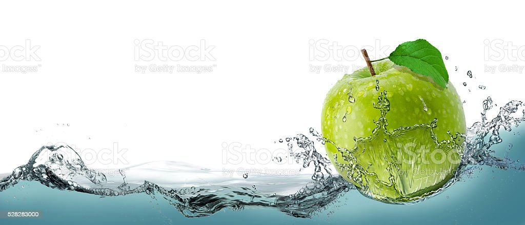 Green, juicy apple as a card on the water background. stock photo