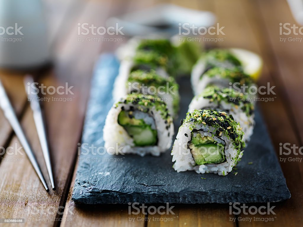 Green kale sushi roll stock photo
