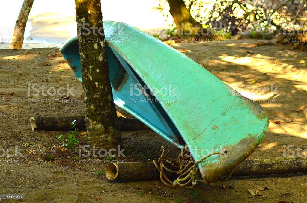 Green kayak on the beach royalty-free stock photo