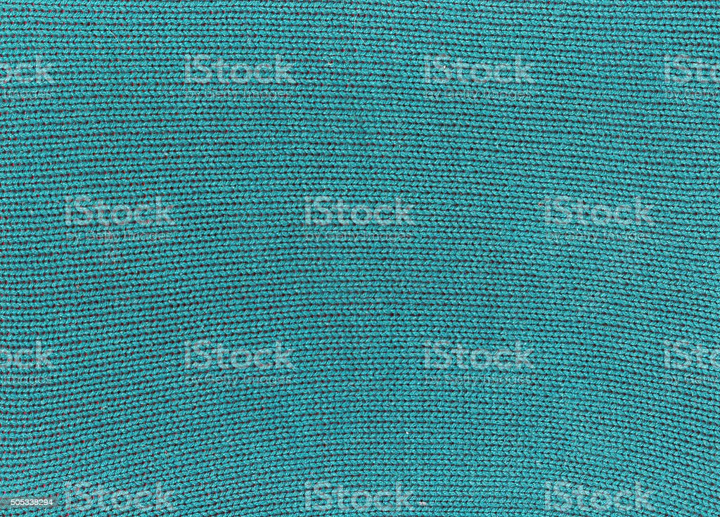 Green knitted material texture. stock photo
