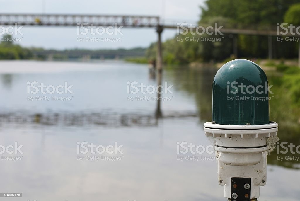 Green lamp on river stock photo