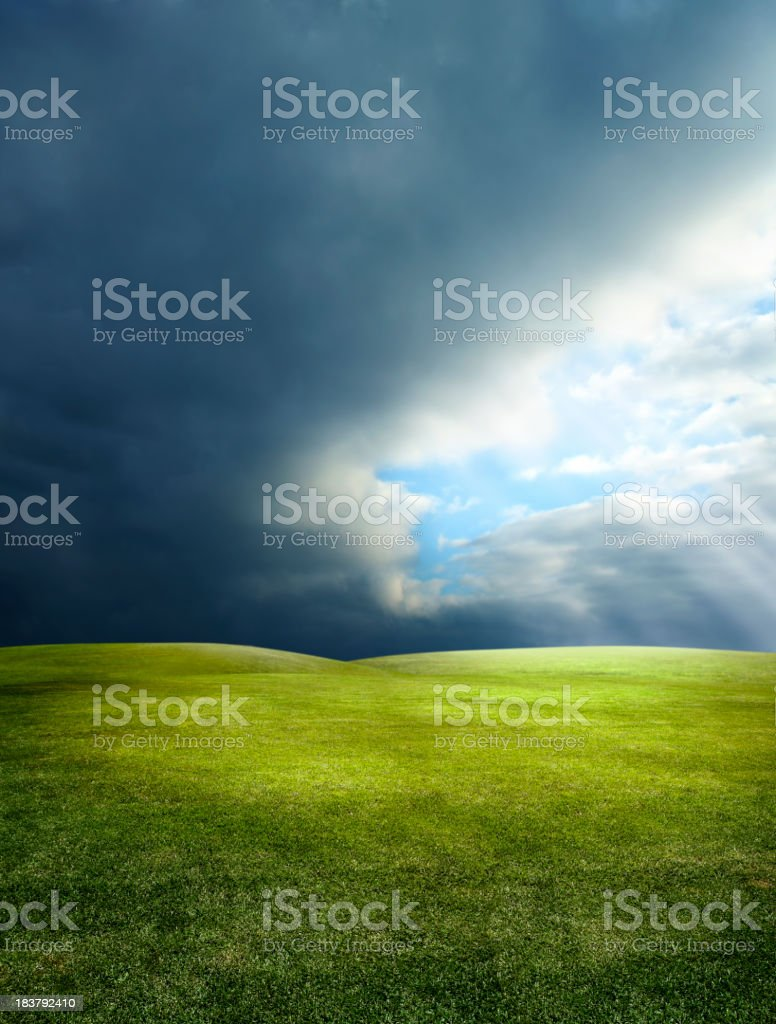 green landscape and sunbeam stock photo