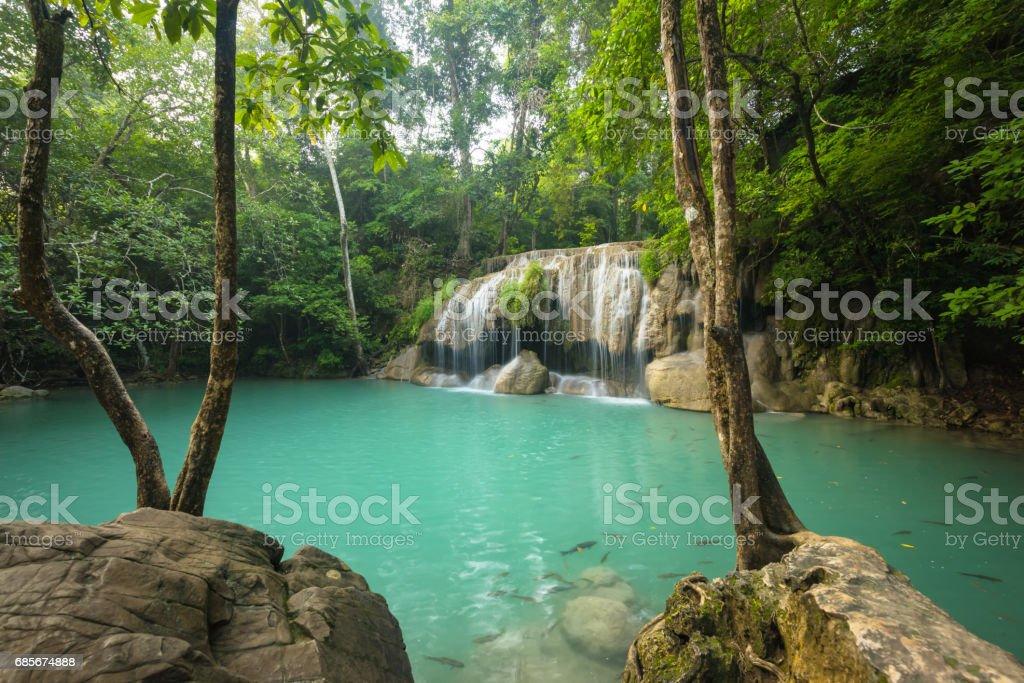 Green landscape with green waterfall, Erawan waterfall stock photo