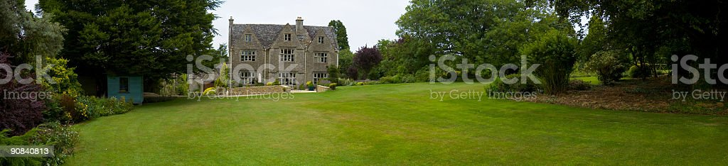 Green lawn and large luxury home royalty-free stock photo