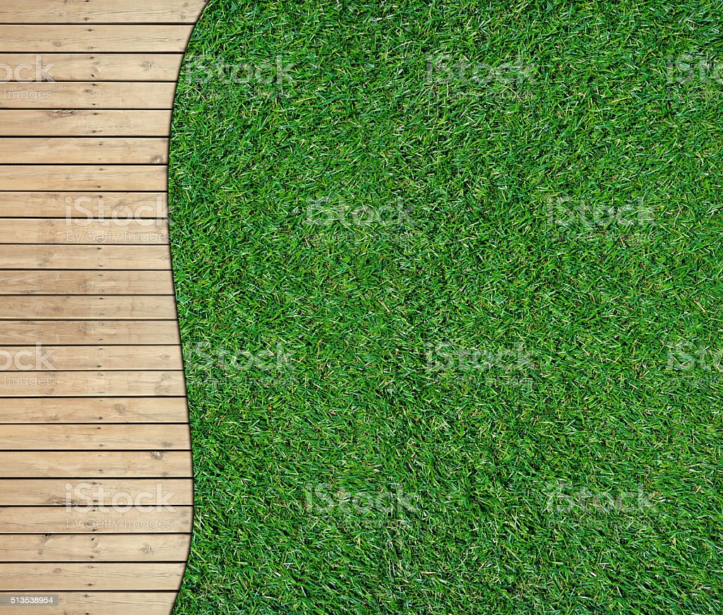 Green lawn and wooden floor texture background stock photo