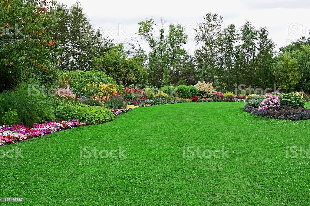 Green Lawn in Landscaped Formal Garden stock photo