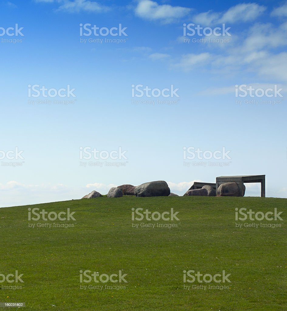 Green lawn with large rocks. royalty-free stock photo