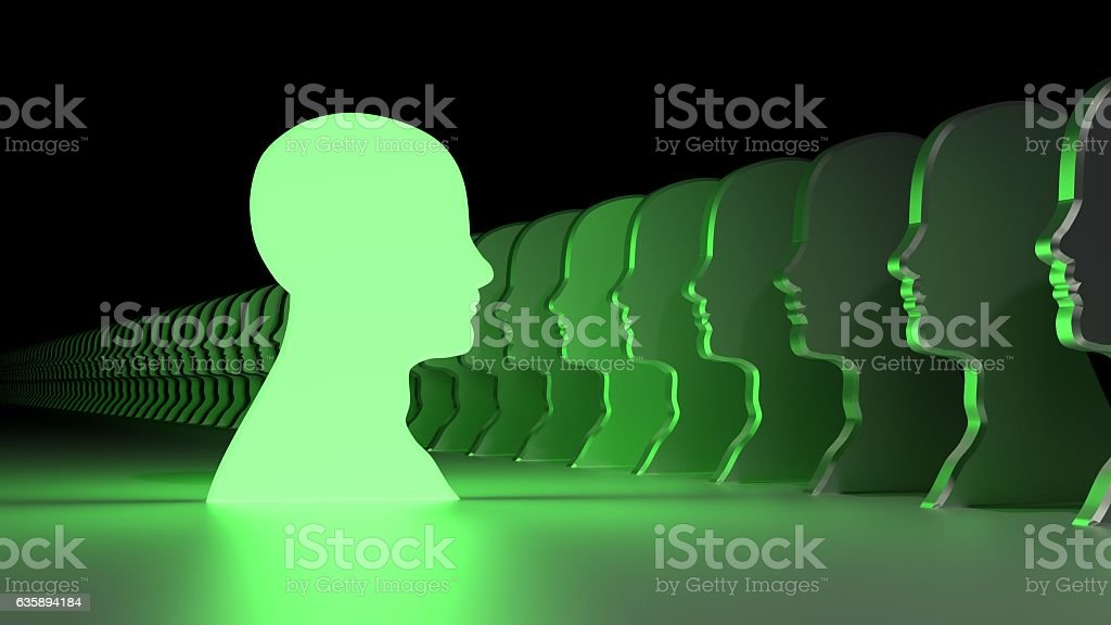 Green leadership head symbol facing the crowd stock photo
