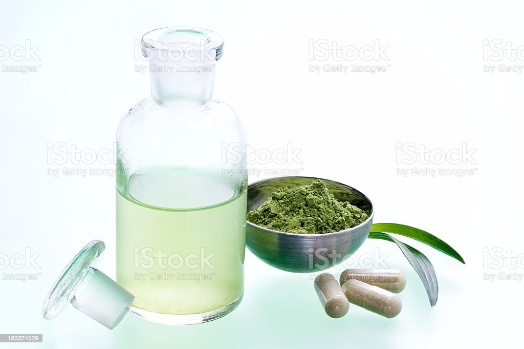 A green leafy natural medicine and its juice on table stock photo