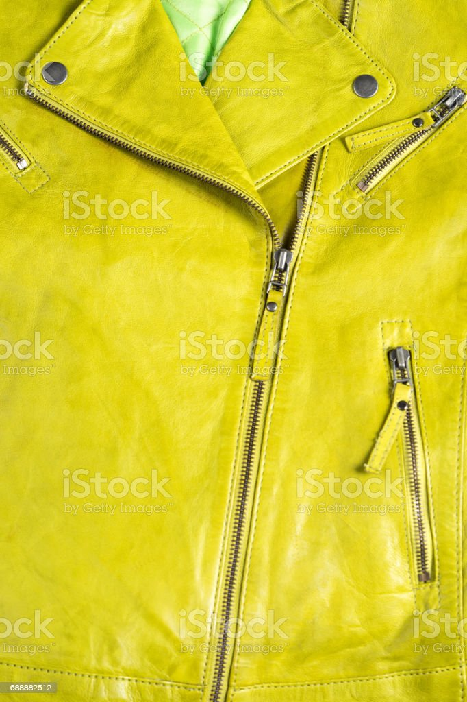 Green leather jacket. Leather jacket macro details. Jacket zippers and pockets stock photo