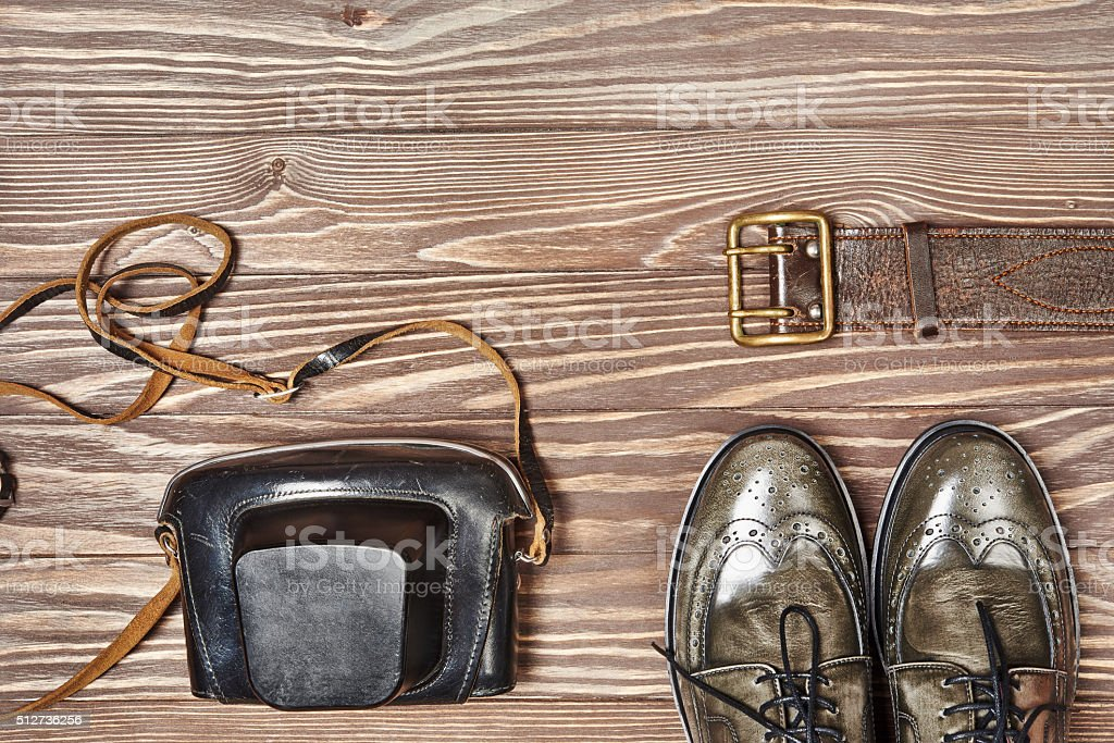 Green leather shoes and retro style camera stock photo