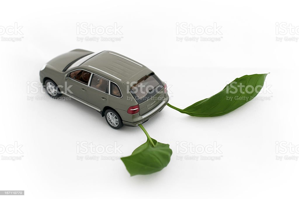 Green leaves and a car.Ecology conception stock photo
