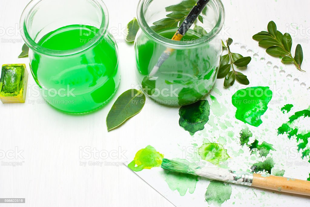 Green leaves draws the artist. Concept art. Workplace, designer stock photo