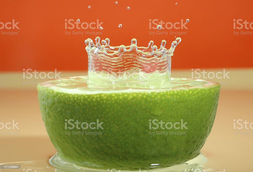Green lemon and water drop royalty-free stock photo
