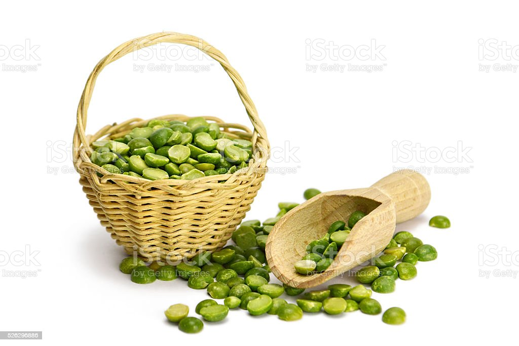 Green lentils in the basket isolated on white stock photo