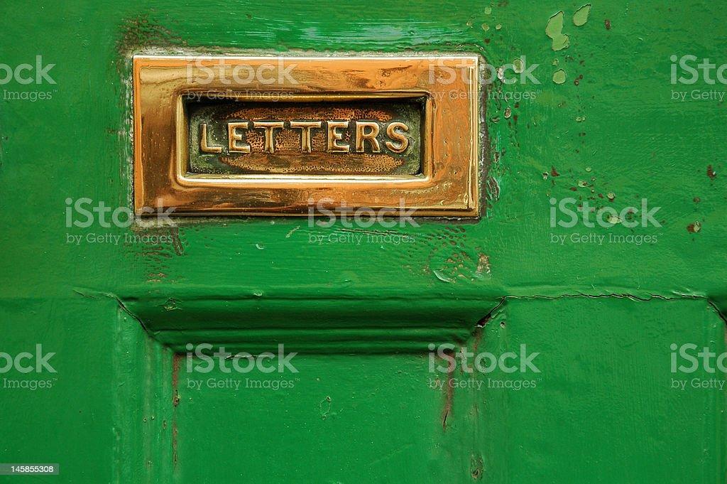 Green letter slot stock photo