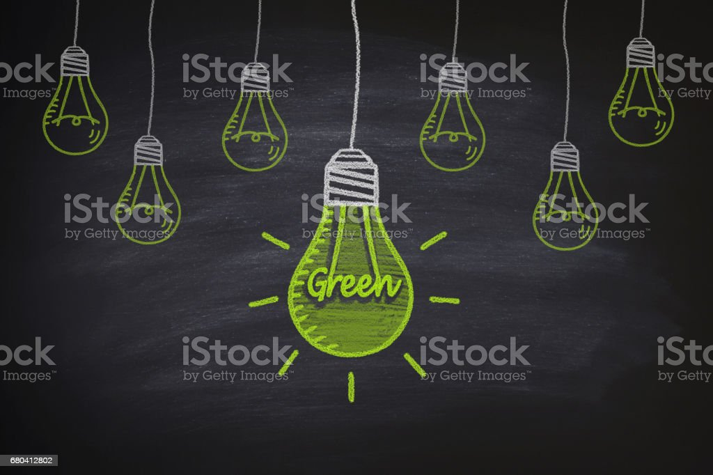 Green light bulbs on the blackboard stock photo