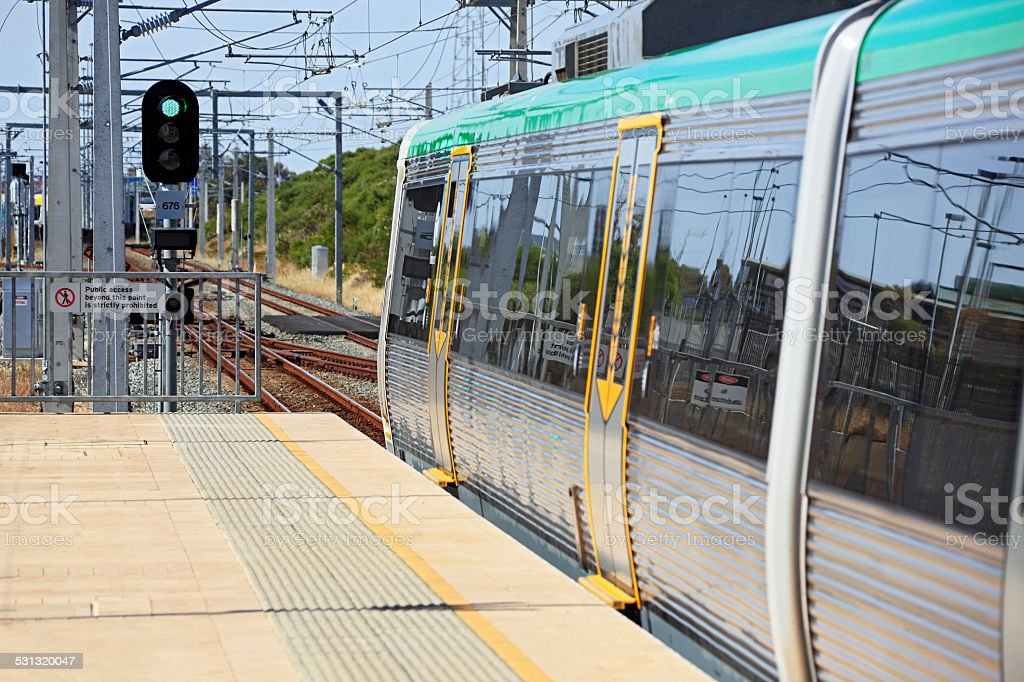 Green light for electric metro train in station platform stock photo