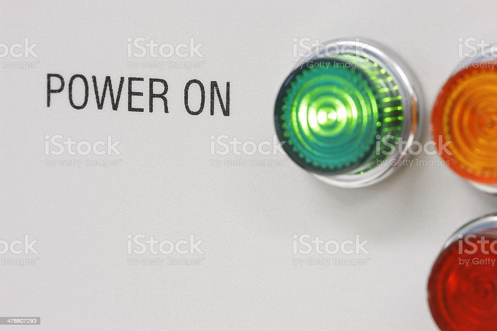 Green light indicating 'POWER ON' at section of industrial machine stock photo