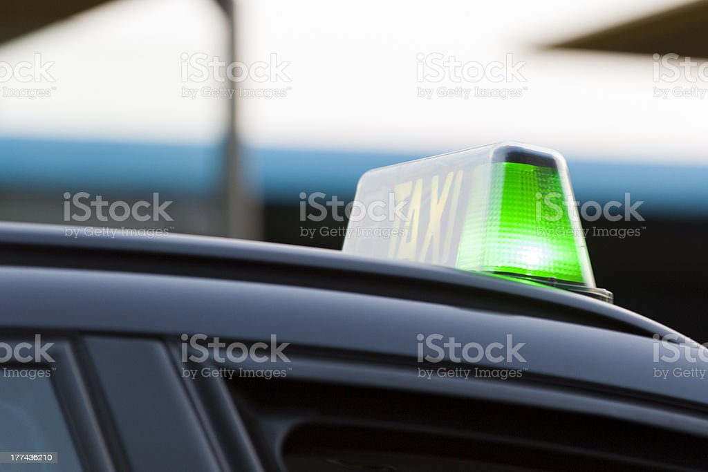 Green light on a taxi royalty-free stock photo