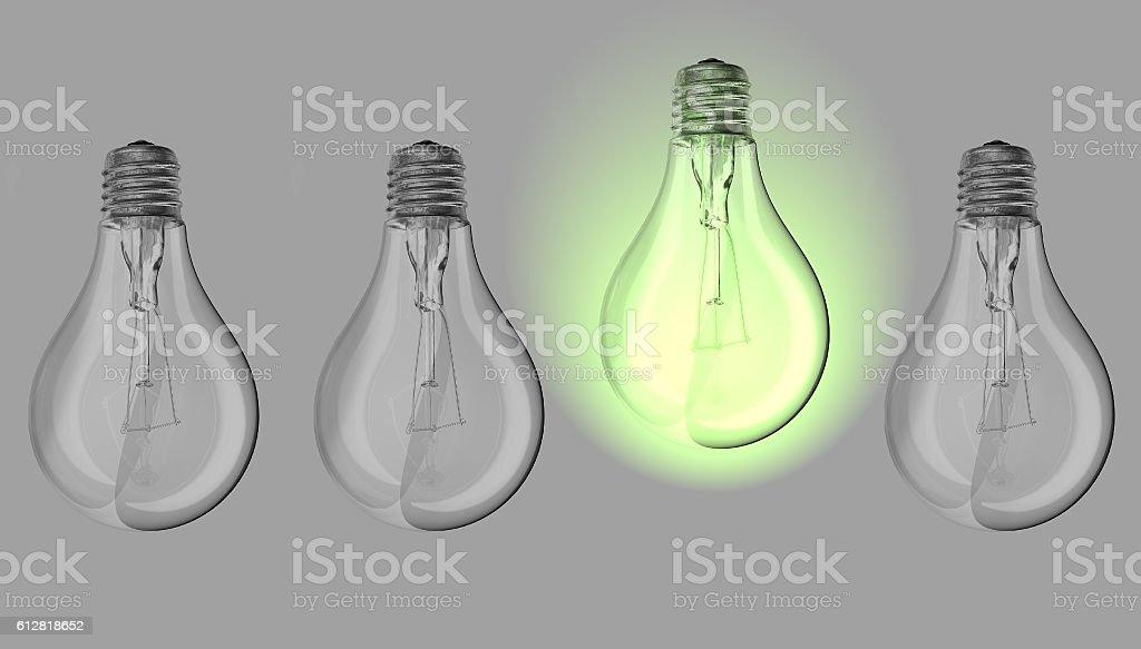 Green lightbulb between many lightbulbs stock photo