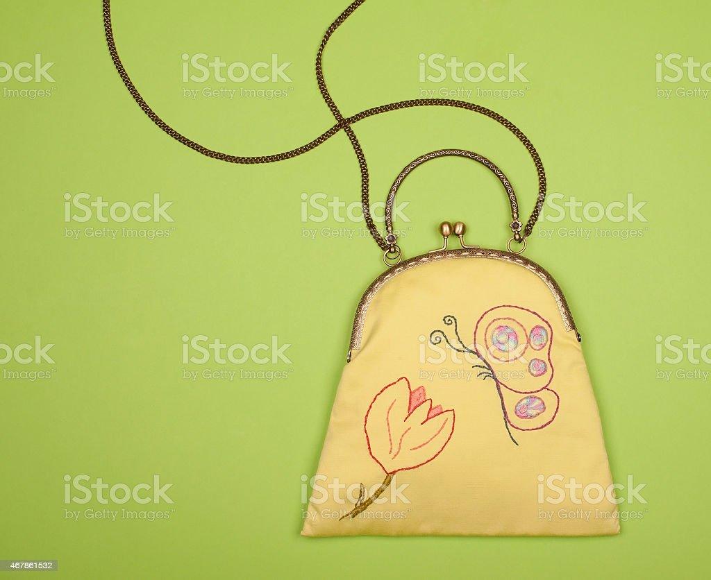 Green linen purse with spring motiv stock photo