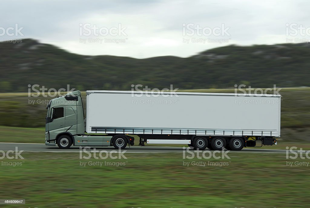 green lorry with white trailer drive fast royalty-free stock photo