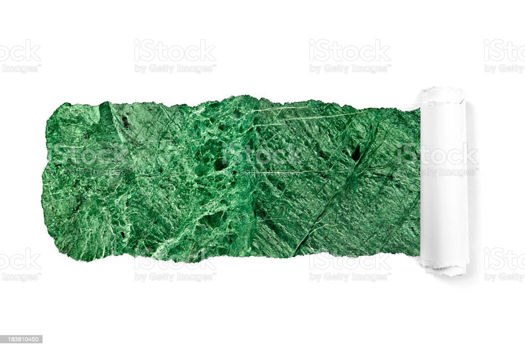 Green marble through white torn paper royalty-free stock photo
