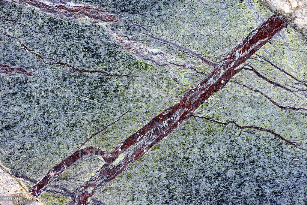 Green marble with dark red lines stock photo