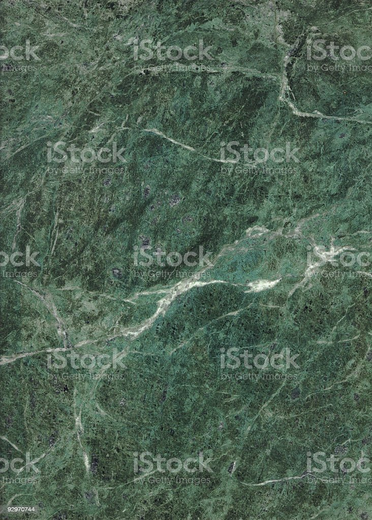 Green marble-texture background with white accents stock photo