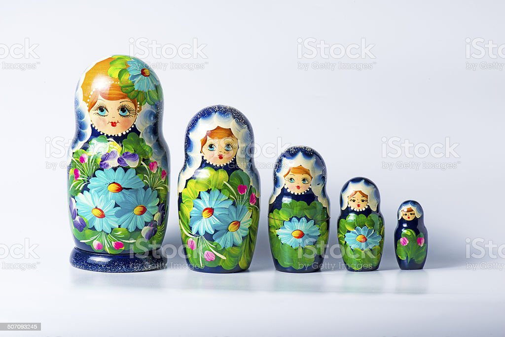 Green matryoshka isolated on white stock photo