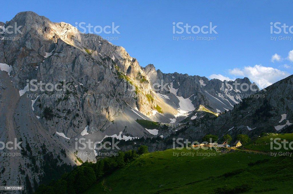 green meadow under the mountain peak royalty-free stock photo