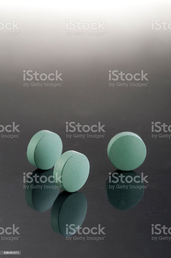 Green medicine pills. stock photo