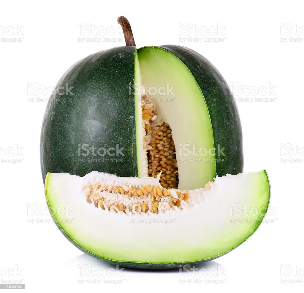 Green melon with slice cut out on white background stock photo