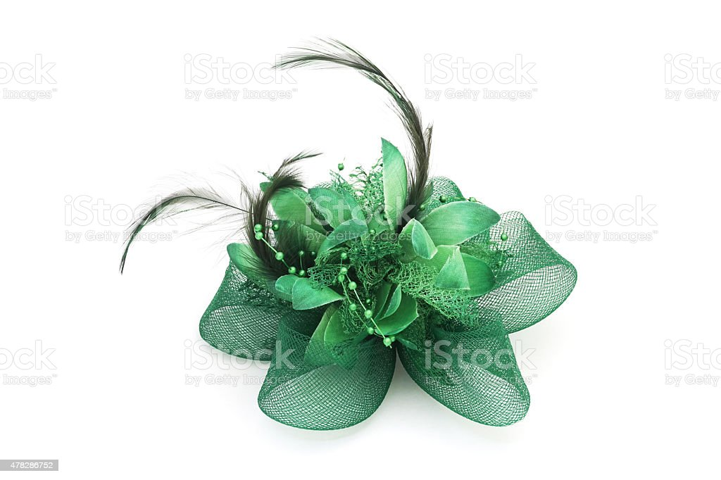 green mesh bow hair clip with feather stock photo