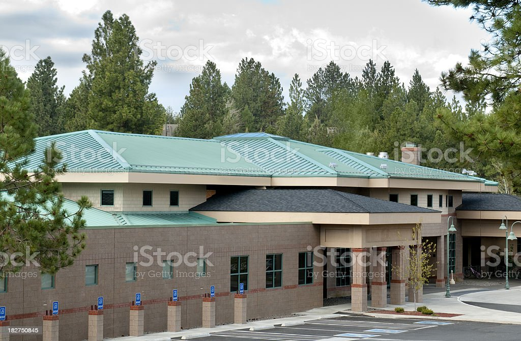 Green metal roofing w/building exterior stock photo