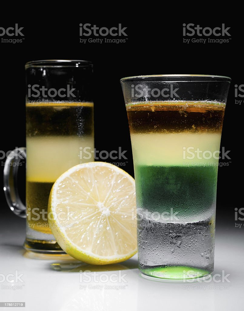 Green mexican and melon liquer shot cocktail stock photo