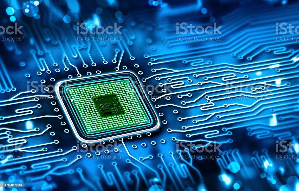 Green microchip set in a blue printed circuit board stock photo