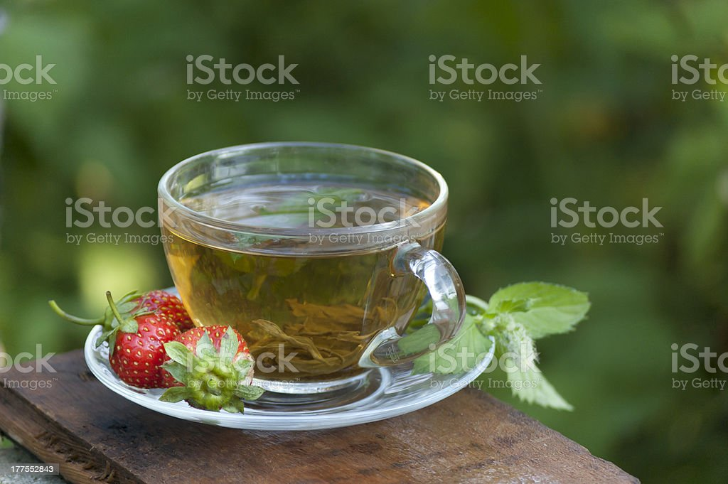 green mint tea with strawberry at nature background royalty-free stock photo