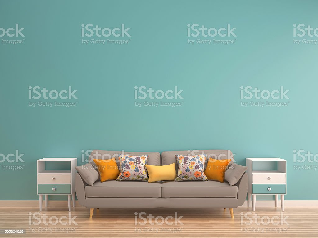 green mint wall with sofa & sideboard on wood floor stock photo