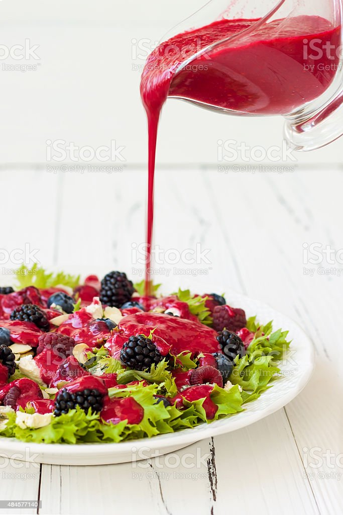 Green mixed berry salad with seeds, blue cheese and almonds stock photo